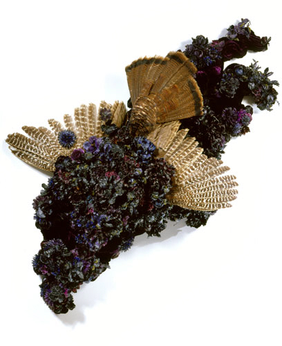 Petah Coyne Canto VIII, 2008 Silk flowers, taxidermic bird, thread, silk/rayon velvet, felt, wax, pearl-headed hatpins, spray paint, pigment, chicken-wire fencing, wire, plywood, metal hardware, cable, and cable bolts Courtesy the artist and Galerie Lelong, New York